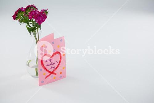 Close-up of happy mothers day card with flower vase
