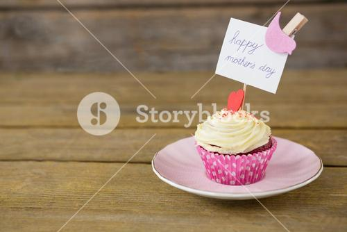 Close-up of delicious cupcake with happy mothers day label