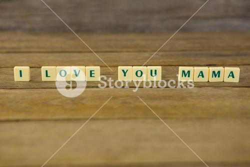 I love you mom block on wooden background