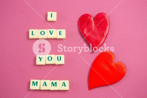 Red heart next to white blocks displaying I love you mama message