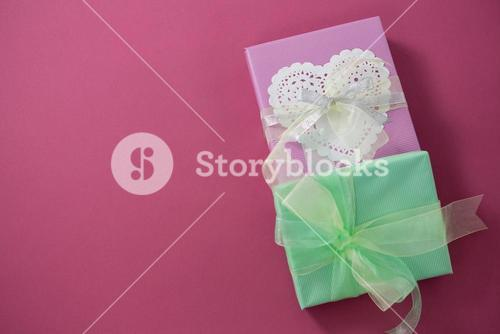 Gift boxes against pink background