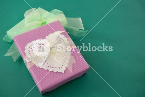 Gift boxes against green background