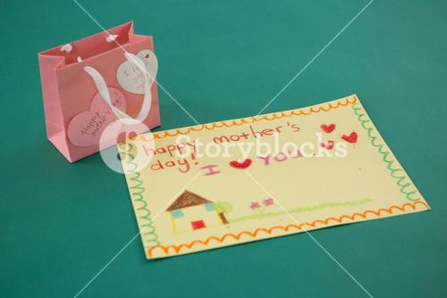 Pink gift bag with heart shape tag and greeting card