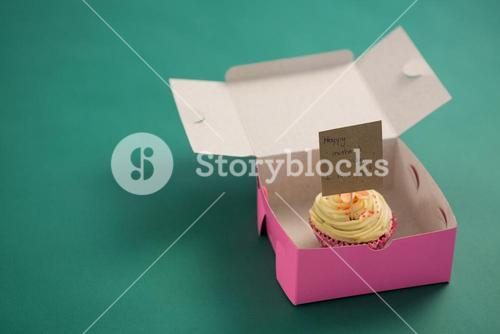 Cupcake against with happy mother day card green background