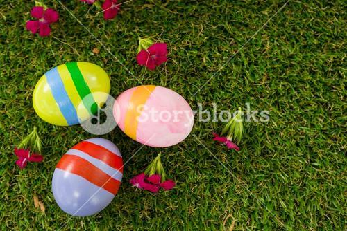 Painted Easter egg on grass