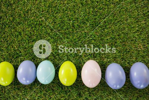 Colored Easter egg on grass
