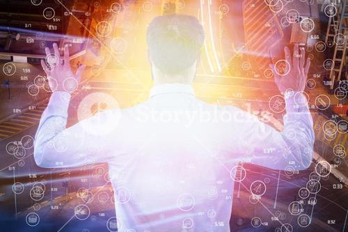 Composite image of rear view of entrepreneur pretending to use invisible screen 3d