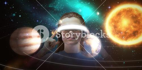 Composite image of beautiful brunette using virtual reality headset 3d