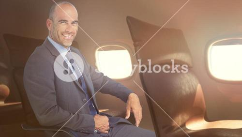 Composite image of portrait of confident businessman sitting on chair