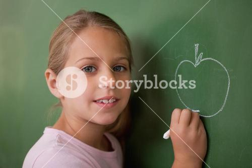 Schoolgirl drawing an apple