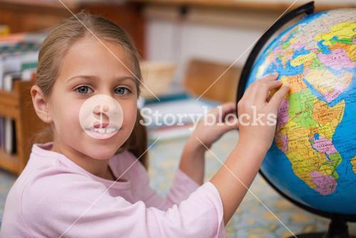 Schoolgirl pointing at a country