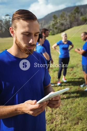 Man using digital tablet in boot camp