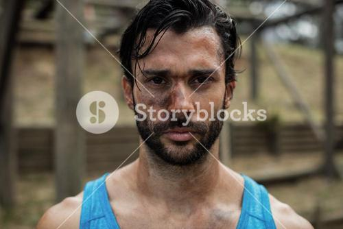 Portrait of determined man in boot camp training