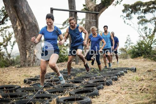 People receiving tire obstacle course training