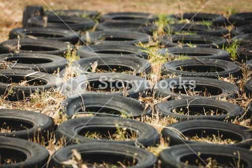Tires placed in a row on ground for obstacle training course