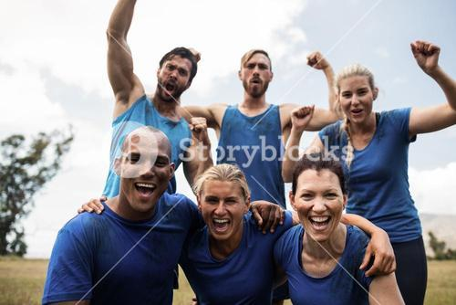 Fit people cheering together