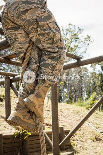 Military soldier training rope climbing