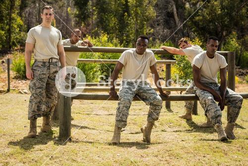 Military soldiers relaxing on fitness trail