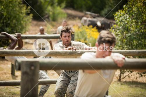 Military soldiers training on fitness trail