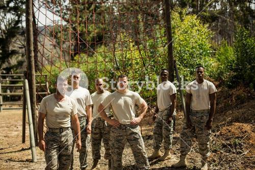 Military soldiers standing near fitness trial