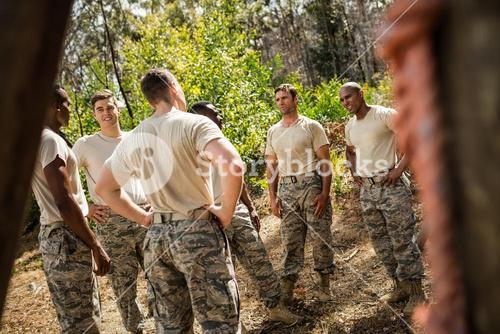 Military soldiers interacting with each other