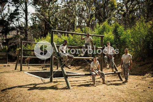 Soldiers sitting on the obstacle course in bootcamp