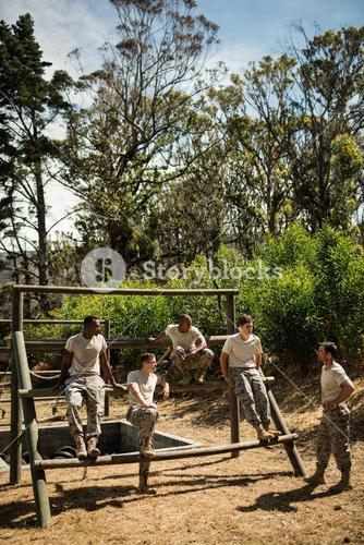 Soldiers sitting on the obstacle course