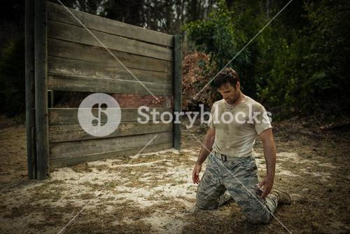 Soldier sitting on his knees