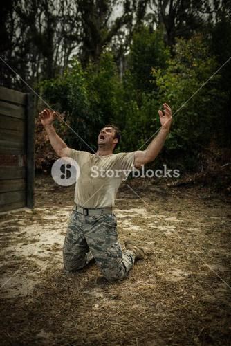 Soldier screaming with arms wide open