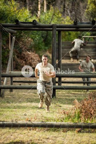 Soldier running through obstacle course