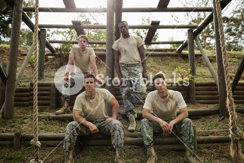 Soldiers sitting on the obstacle course in boot camp
