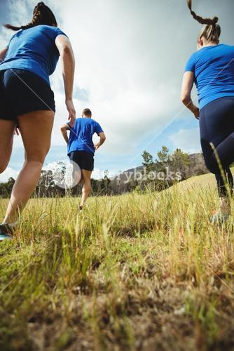 Fit people running in bootcamp