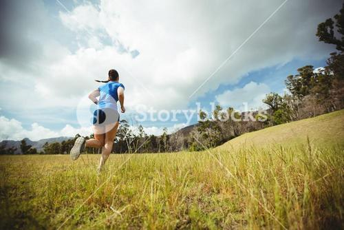 Fit woman running in bootcamp