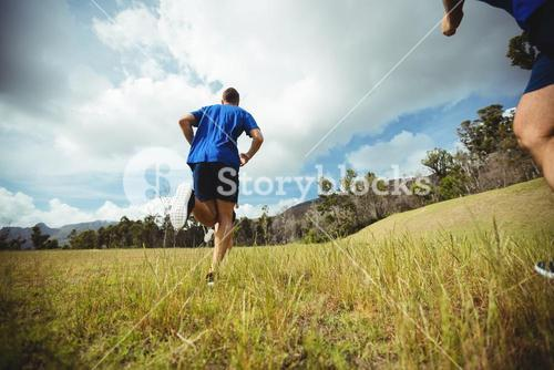Fit man running in bootcamp