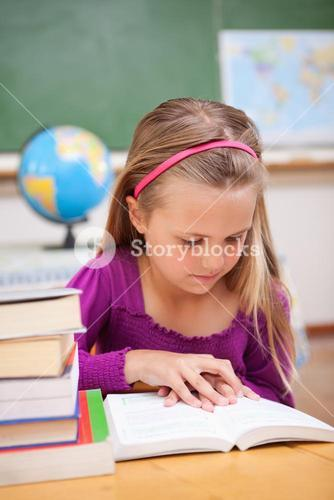 Portrait of schoolgirl reading a book