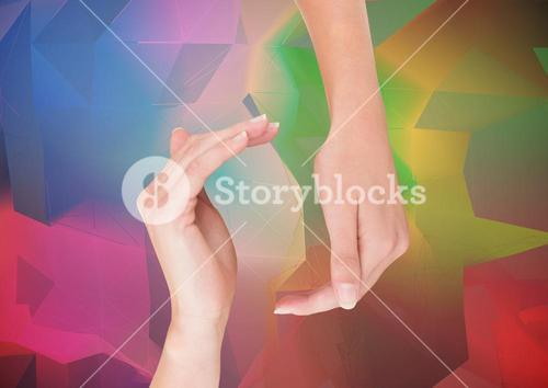 Hands reaching eachoter against abstract background