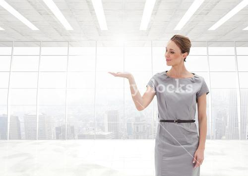 Woman with open palm hand in office