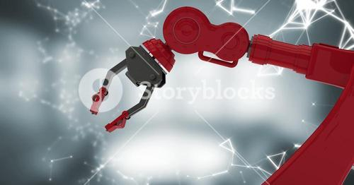 Red robot claw with white interface against blurry grey room