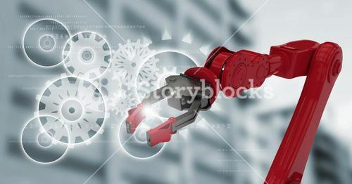 Red robot claw against white cog graphics and blurry building