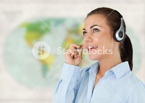 Travel agent with headset against blurry map