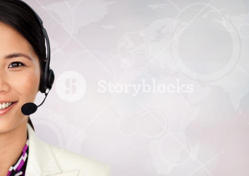 Close up of travel agent with headset against white map