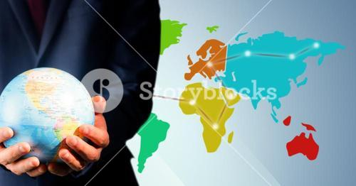 Close up of travel agent holding globe against map with lights