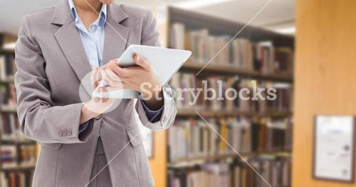 Woman on tablet in Library