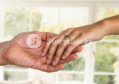 Wedding engaged couple holding hands by window