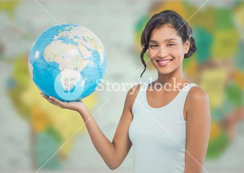 Woman with globe against blurry map