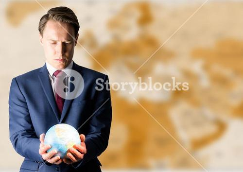 Man with globe against brown blurry map