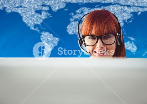 Travel agent behind computer against map with clouds and blue background