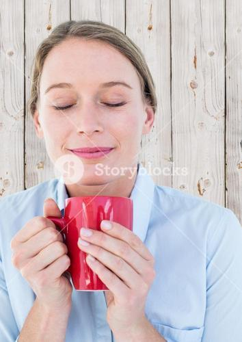 Close up of woman with red mug against white wood panel