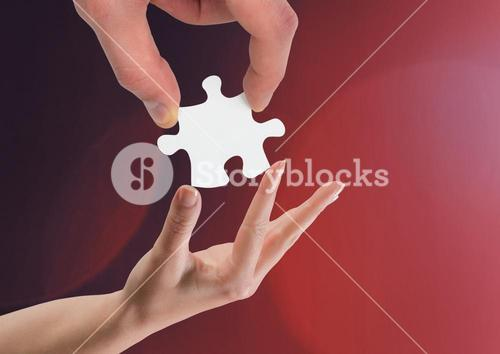 Hands holding jigsaw piece helping against red background
