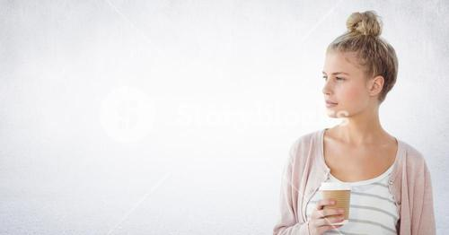 Woman looking to the side coffee cup against white wall